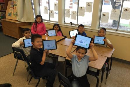 "Image of 1st graders learning computer science during the national ""Hour of Code""!"